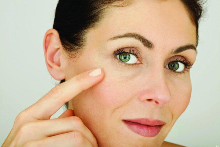 Woman touching face, portrait